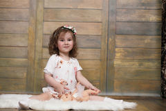 Little girl with curly hair, having fun while posing Stock Photos