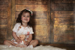 Little girl with curly hair, having fun while posing Royalty Free Stock Photography