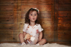 Little girl with curly hair, having fun while posing Royalty Free Stock Photo