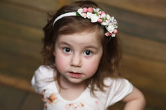 Little girl with curly hair, having fun while posing Royalty Free Stock Photos