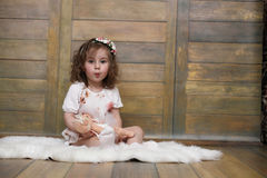 Little girl with curly hair, having fun while posing Royalty Free Stock Image