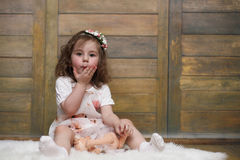 Little girl with curly hair, having fun while posing Stock Photo