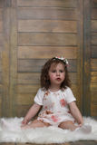 Little girl with curly hair, having fun while posing Royalty Free Stock Images