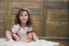 Little girl with curly hair, having fun while posing Stock Image