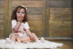 Little girl with curly hair, having fun while posing Stock Images