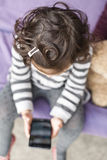 Little girl with curly hair Stock Photo