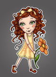 Little girl with curly hair in yellow dress holding a flower Stock Image