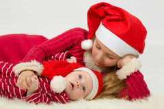 Little girl with cute baby boy lie Royalty Free Stock Photography