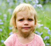 Little girl with a cute grumpy face expression stock image