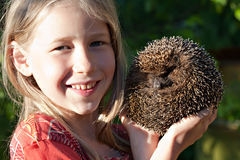Little girl with cute hedgehog Stock Photo
