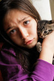 Little girl and cute kitten stock photo