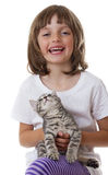Little girl with a cute kitten Stock Photos