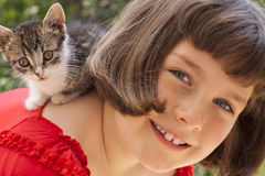 Little girl with cute kitten Stock Photos