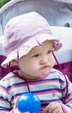 Little girl in the cute sun hat posing with blue ball Royalty Free Stock Photography