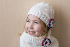 Little girl with cute white hat crochet/knitted hat. Stock Image