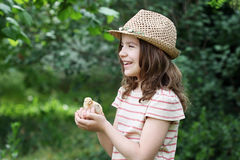 Little girl and cute yellow chicken Royalty Free Stock Image