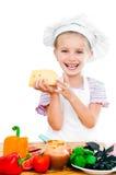 Little girl cuting sausage Stock Image