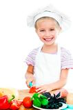 Little girl cuting sausage Stock Photo