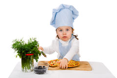 Little girl with cutter and pizza Royalty Free Stock Photos