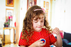 Little girl cutting adhesive tape Royalty Free Stock Image