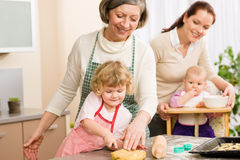Little girl cutting dough for cookies Stock Photo