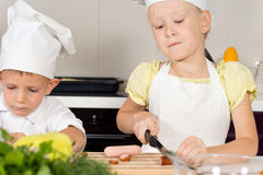 Little girl cutting ingredients for homemade pizza Stock Image