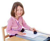 Little girl is cutting paper Royalty Free Stock Photo