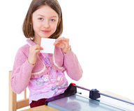 Little girl is cutting paper Stock Photo