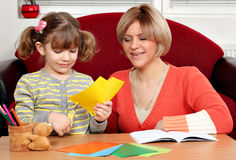 Little girl cutting paper Royalty Free Stock Image