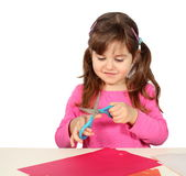 Little Girl Cutting with Scissors Royalty Free Stock Photos