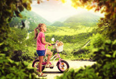 Little girl cycling Royalty Free Stock Image