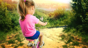 Little girl cycling Stock Image