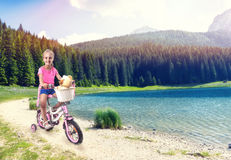 Little girl cycling Royalty Free Stock Photography
