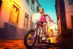 Little girl cycling Stock Images