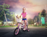 Little girl cycling Stock Photos