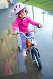 Little girl cyclist Royalty Free Stock Photos