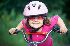 Little girl cyclist Stock Images
