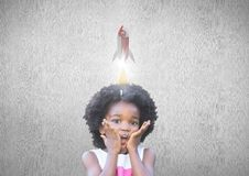 Little girl with a 3D rocket above her head. Digital composite of Little girl with a 3D rocket above her head Royalty Free Stock Photography