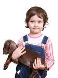 Little girl with dachshund puppy Stock Photography