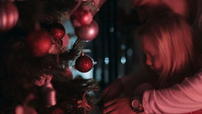 Little girl with dad decorate the Christmas tree stock footage