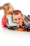 A little girl and dad are played Stock Photo