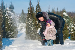 A little girl and dad run and play with the snow, lifestyle, winter holidays. A little girl and dad run and play with the snow royalty free stock photography