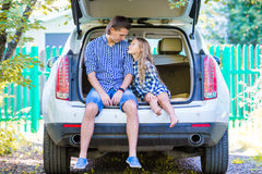 Little girl with dad sitting in a car just before leaving for a car vacation Stock Photo