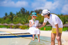 Little girl and dad during tropical beach vacation Royalty Free Stock Image