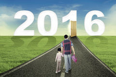 Little girl and dad walk toward number 2016 Stock Photography