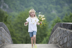 Little girl with daisies in her hair Royalty Free Stock Image