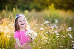Little girl in daisy flower field Stock Photo
