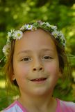 Little girl in daisy head wreath royalty free stock photography