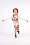 Little girl in dance creations with red hat Stock Images