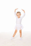 Little girl in the dance pose stock photography